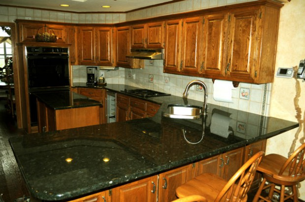A Photo of installed Peacock Green Granite Kitchen Remodel.