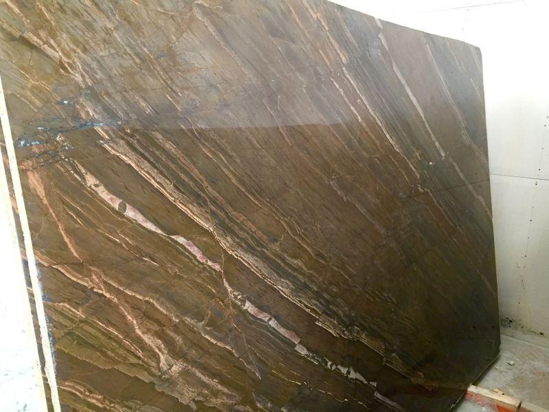 Photo of Exuberant Brown Quartzite Slabs.