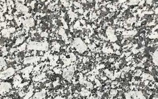 Grand White Granite – 3CM Slabs with A Black & White Background