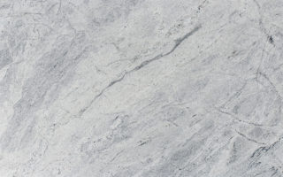 Himalaya Granite – White Background with Cool Medium Gray Accents