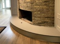 This fireplace features 3CM Fossil Gray Quartz